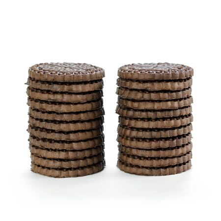 Two stacks of chocolate chip cookies.