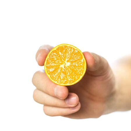Hand holding a tangerine cut in half. Close up. Isolated on white background. Stock fotó - 134180771