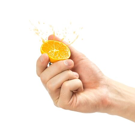 Hand holding a tangerine cut in half. Close up. Isolated on white background. Stock fotó