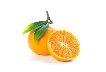 Tangerine with green leaves. Close up. Isolated on white background.