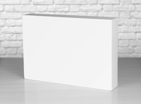 White box from laptop is worth on the table. Close up.