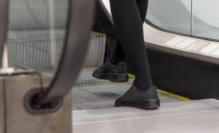 A man steps on the escalator. Legs close up. Stock fotó - 134180818