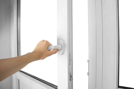 A hand opens the white plastic door. Close up.