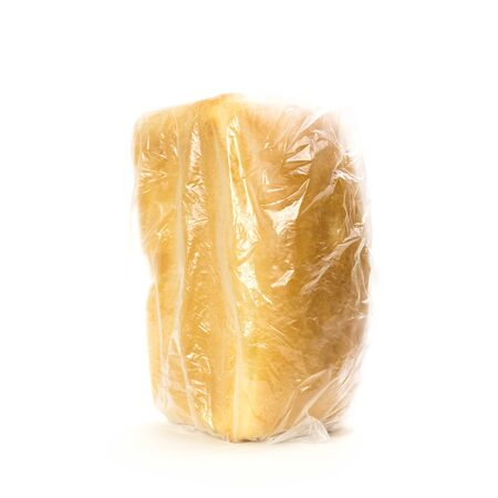 A loaf of fresh bread in a bag. Close up. Isolated on white background. Stock fotó