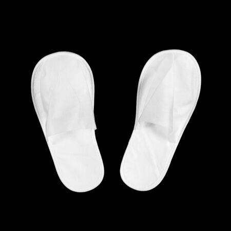 White house slippers. Isolated on black background. Close up.