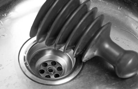 Plunger in the sink. A tool for cleaning clogs in sinks. Close up.