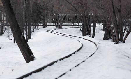 The winding railway. Snowy railroad tracks.