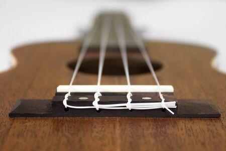 Bridge at ukulele. Close up. Isolated on white background.