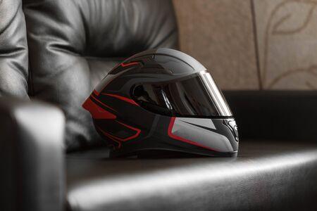 Beautiful black and red motorcycle helmet with black visor. Stock fotó