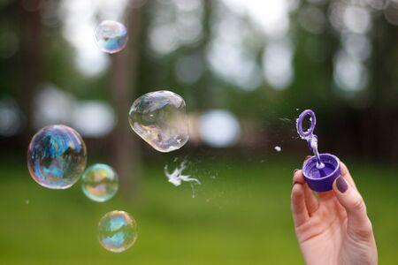 A man blows soap bubbles. Close up.