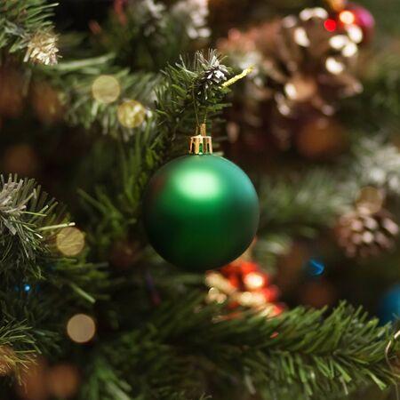 Christmas ball on a green Christmas tree. Close up.