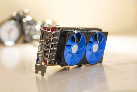 A beautiful video card with a powerful cooling system for a desktop computer.