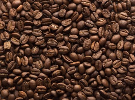 Texture of coffee beans. Brown coffee beans. Close up.