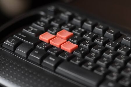 Black keyboard with bright game keys. Close up.