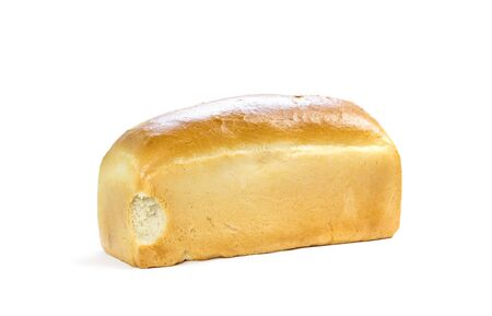 A bitten loaf of bread. A half-eaten loaf of bread. Close up. Isolated on a white background.