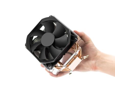 The hand holds powerful cooling for the desktop processor. Close up. Isolated on a white background.
