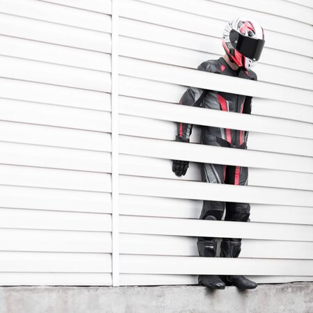 The motorcyclist self-isolated. The man was stuck in the wall. Stock Photo