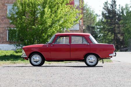 KRASNOYARSK, RUSSIA - May 19, 2020: Red retro car Moskvich 412. Whitewalls. Car of the year 1982.