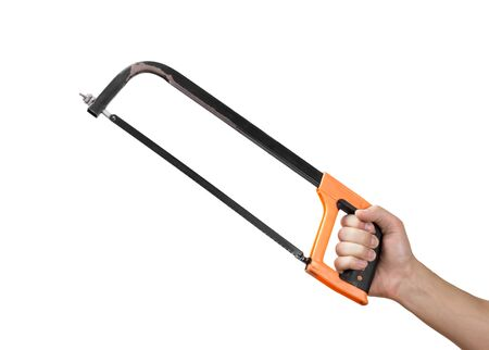 Hand holding a saw on metal. Close up. Isolated on a white background. Stock Photo
