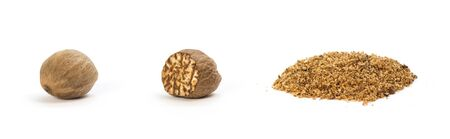 Set of nutmeg. Whole and grated. Close up. Isolated on a white background. Фото со стока