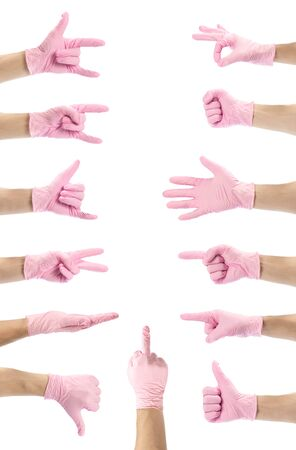 Hand signs. A set of hands in the pink medical gloves. Close up. Isolated on a white background.