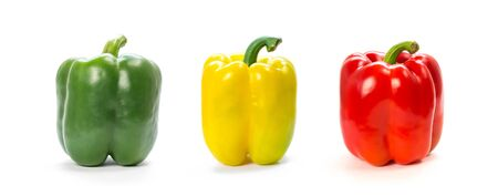 Green, yellow and red bell peppers. Close up. Isolated on a white background. Фото со стока