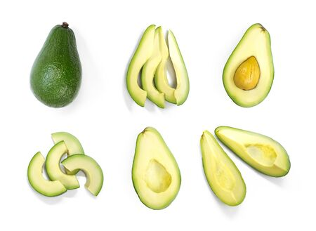The set of sliced avocado. Close up. Isolated on a white background. Фото со стока