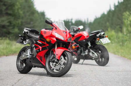 KRASNOYARSK, RUSSIA - June 30, 2020: Two red and black sportbike Honda CBR 600 RR 2005 PC37. Sajtókép