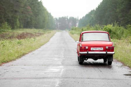 KRASNOYARSK, RUSSIA - July 14, 2020: Red retro car Moskvich 412. Whitewalls. Car of the year 1982. Sajtókép