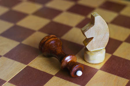 Chess. The knight's move. Horse overthrew the Queen.