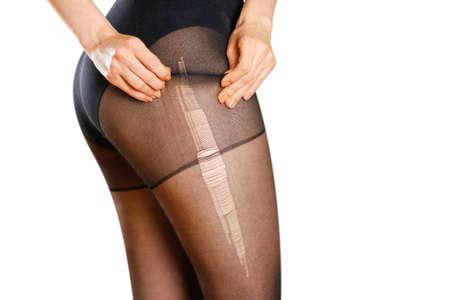 Beautiful girl in ripped black nylon pantyhose. Stock fotó