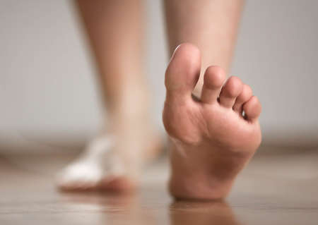 The foot of a person walking forward.