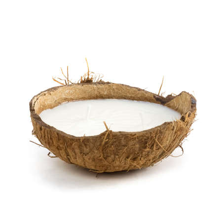 Candle in coconut. Close up. Isolated on a white background.