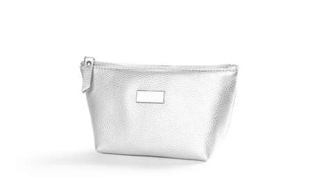 Small women purse in silver color. Close up. Isolated on a white background. Banque d'images