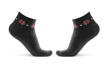 Black short socks on the leg. Close up. Isolated on a white background.