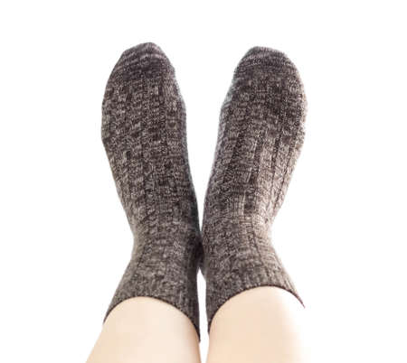 Wool socks on the foot. Close up. Isolated on a white background.