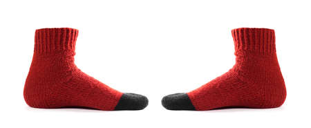 Red socks on the leg. Close up. Isolated on a white background.