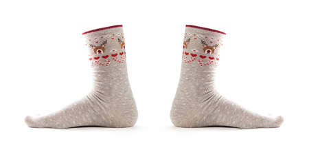 Christmas socks on the foot. Close up. Isolated on a white background. Archivio Fotografico