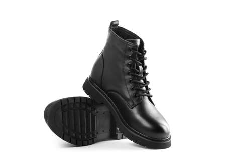 Black leather boots with laces. Close up. Isolated on a white background.