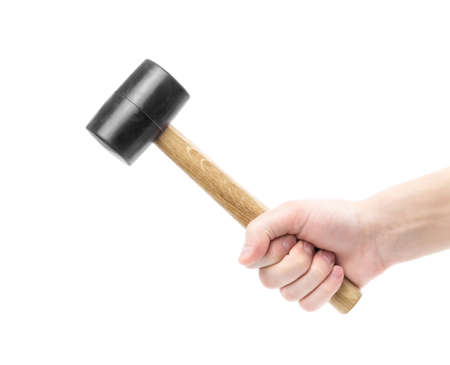 The hand holds a rubber mallet with a wooden handle. Ð¡lose up. Isolated on a white background.