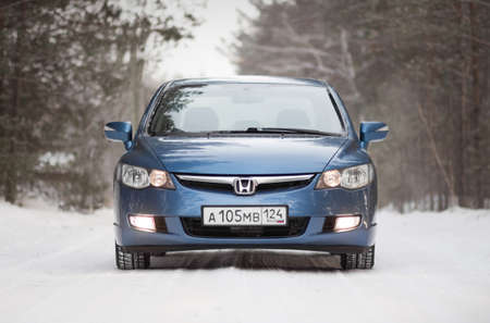 KRASNOYARSK, RUSSIA - December 31, 2020: Blue car. Sedan Honda Civic 4D FD1 2007.