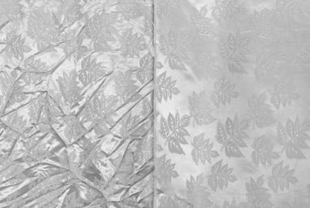 Crumpled and smooth curtains. Close up. Isolated on a gray background.