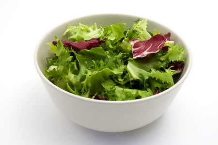 Bowl of salad on a white background photo