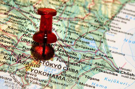 red pushpin: Red pushpin on an atlas (Tokyo)