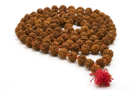Japa Mala (set of beads commonly used by Hindus and Buddhists) on a white background