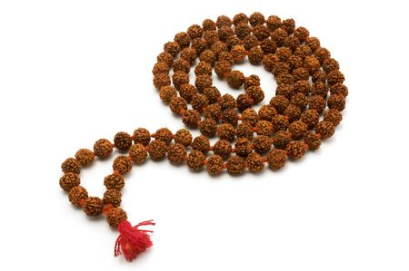 commonly: Japa Mala (set of beads commonly used by Hindus and Buddhists) on a white background
