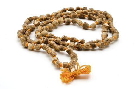 Japa Mala (set of beads commonly used by Hindus and Buddhists) on a white background photo