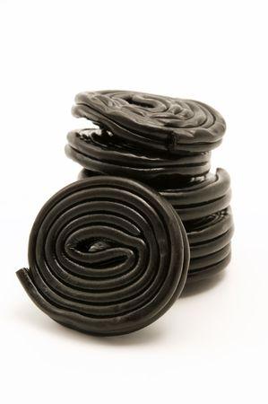 liquorice: Black liquorice wheels on a white background