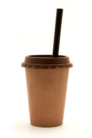 Brown plastic cup with a straw on a white background