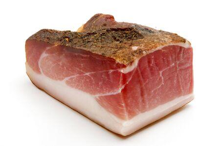 originally: Speck (juniper-flavored ham originally from Tyrol) on a white background Stock Photo